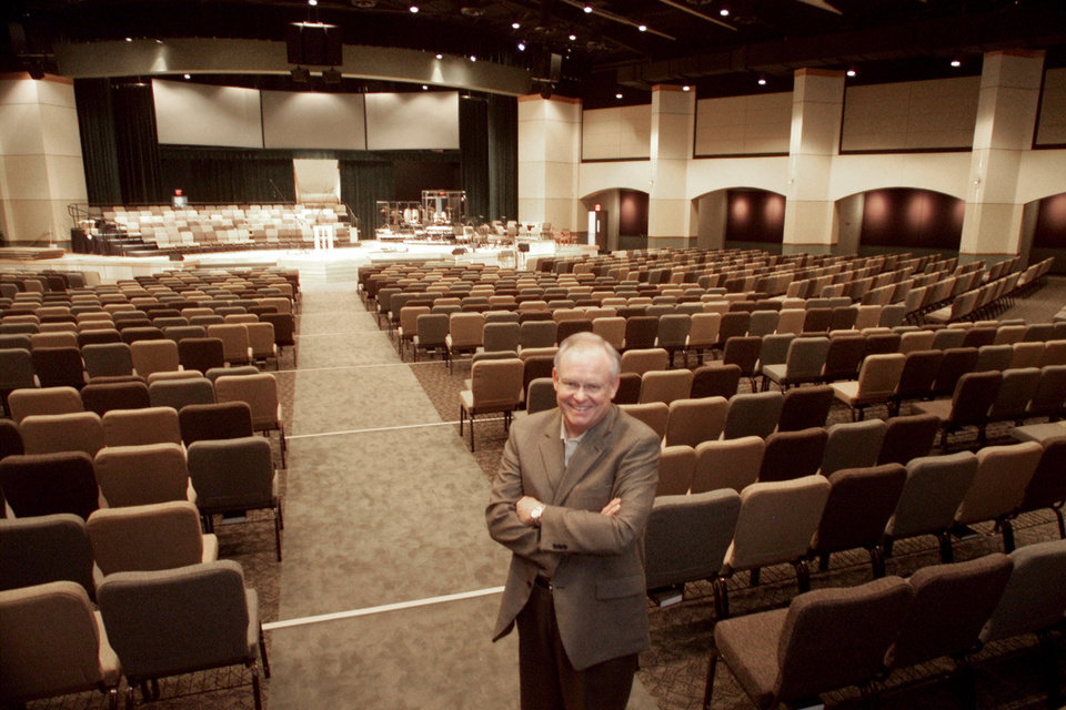 Photo -  In this April 2004 photo, the Rev. Dennis Newkirk, senior pastor of Henderson Hills Baptist Church in Edmond, enjoys the view from the back rows in the sanctuary of the church's complex at Interstate 35 and 15th Street. Photo by Roger Klock, The Oklahoman Archives   Roger Klock -