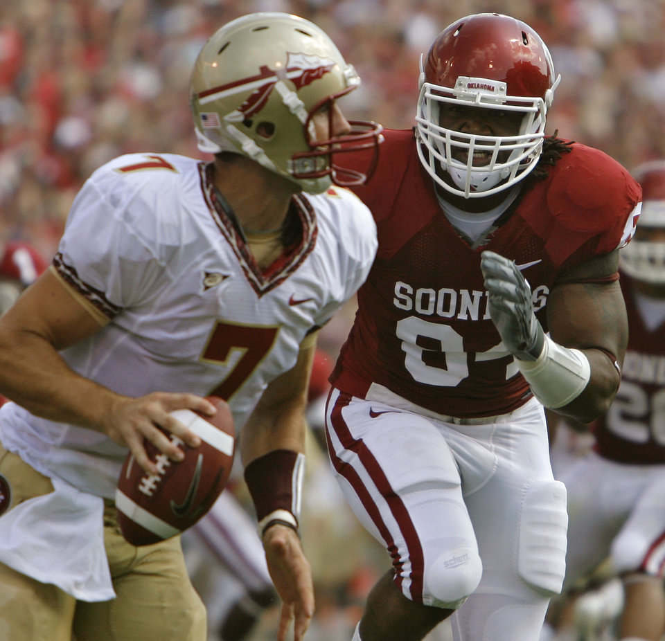 Oklahoma's Frank Alexander (84) chases down Florida State quarterback Christian Ponder (7) during the first half of the college football game between the University of Oklahoma Sooners (OU) and the Florida State University Seminoles (FSU) on Sat., Sept. 11, 2010, in Norman, Okla.  Photo by Chris Landsberger, The Oklahoman ORG XMIT: KOD