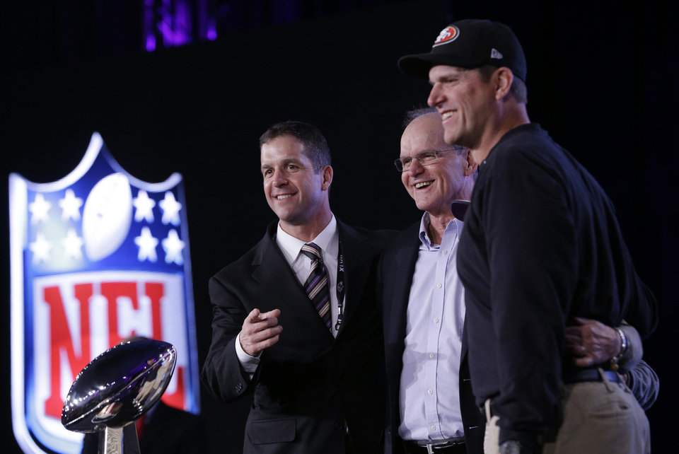 San Francisco 49ers head coach Jim Harbaugh and Baltimore Ravens head coach John Harbaugh pose with their father Jack Harbaugh at a news conference for the NFL Super Bowl XLVII football game Friday, Feb. 1, 2013, in New Orleans. (AP Photo/Patrick Semansky)