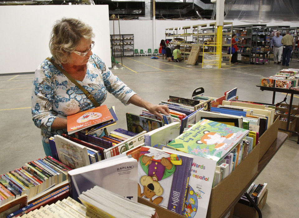 Photo - Billie Slavin, first-grade teacher at Arbor Grove Elementary School in the Putnam City School District, picks out school supplies at Feed the Children's new Teachers Store. Photo by Paul Hellstern, The Oklahoman  PAUL HELLSTERN