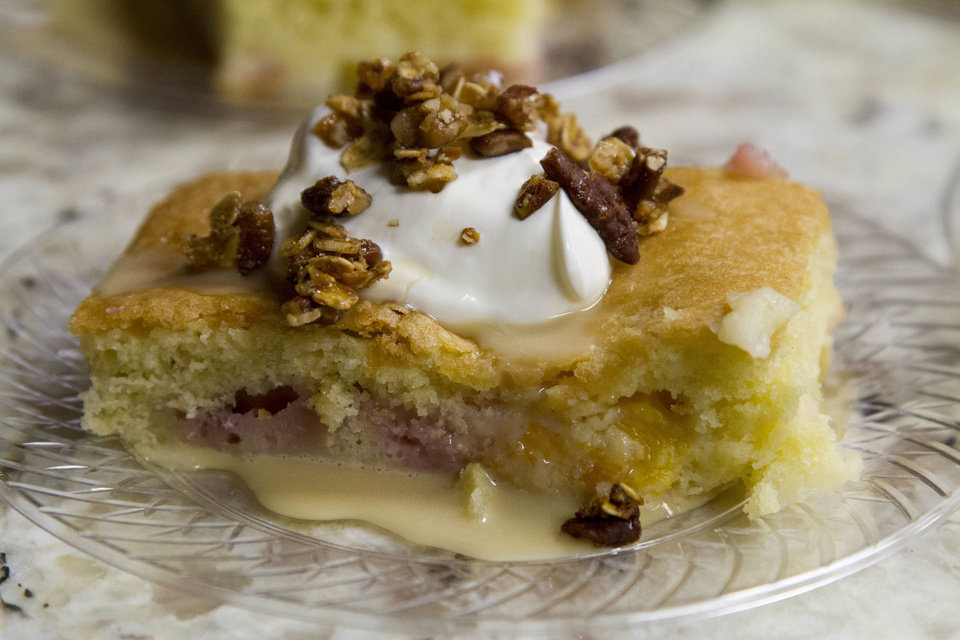 Photo - The surprise of the night came from chef Josh Valentine, who prepared a peach crisp with homemade whipped cream and pecans.  CHRIS JAMES - THE OKLAHOMAN