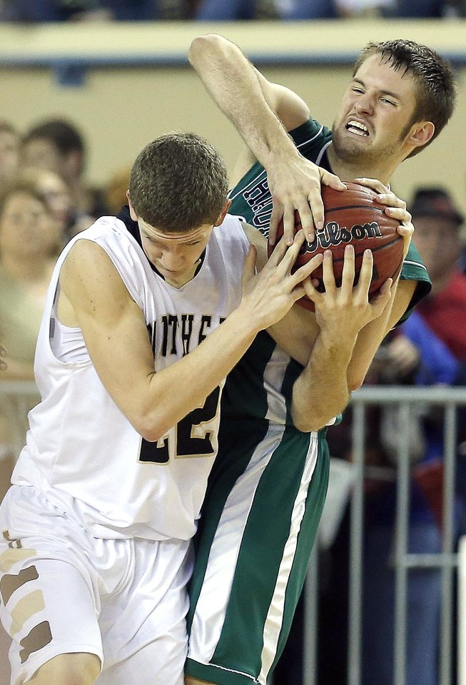 Latta\'s Brogan Cantrell and Haworth\'s Isaiah Daffern fight for ball during the 2A boys state high school basketball championship game between Latta and Haworth at the State Fair Arena in Oklahoma City, Saturday, March 9, 2013. Photo by Sarah Phipps, The Oklahoman
