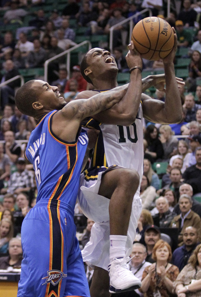 Photo - Oklahoma City Thunder guard Eric Maynor (6) fouls Utah Jazz guard Alec Burks (10) in the fourth quarter during an preseason NBA basketball game Friday, Oct. 12, 2012, in Salt Lake City. The Jazz defeated the Thunder 97-81. (AP Photo/Rick Bowmer) ORG XMIT: UTRB113