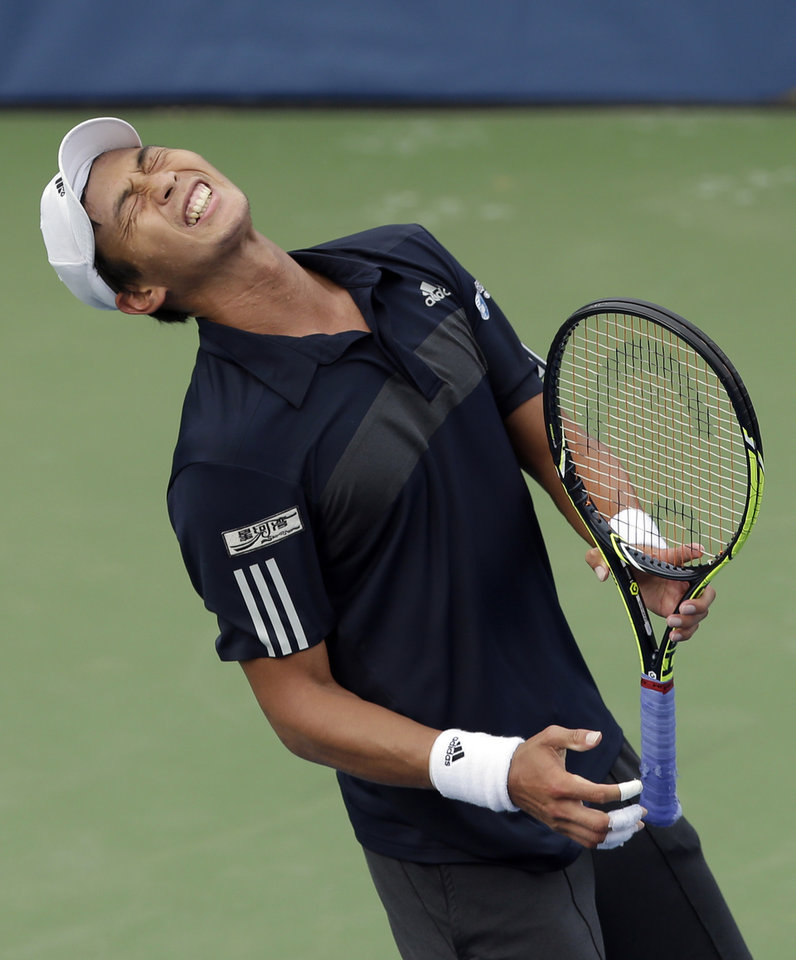 Photo - Yen-Hsun Lu, of Taiwan, reacts after losing a point in the final game against Lukas Rosol, of Czech Republic, in their semi-final match at the Winston-Salem Open tennis tournament in Winston-Salem, N.C., Friday, Aug. 22, 2014. Rosol defeated Lu 7-5, 4-6, 6-4. (AP Photo/Chuck Burton)
