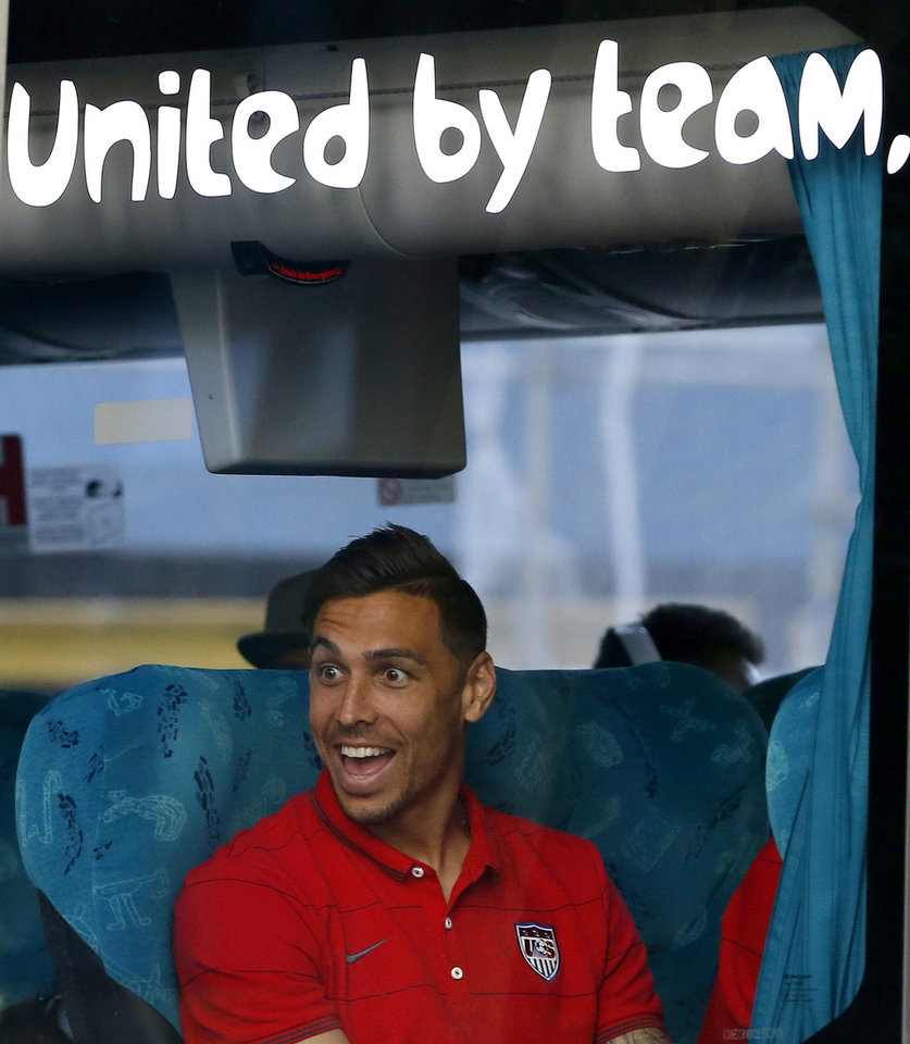 Photo - United States' Geoff Cameron reacts as the team bus arrives at the team hotel in Sao Paulo, Brazil, Monday, June 9, 2014. The U.S. will play in group G of Brazil's 2014 soccer World Cup. (AP Photo/Julio Cortez)