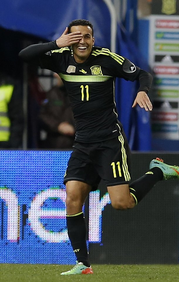 Photo - Spain's Pedro Rodriguez celebrates after scoring against Italy during a friendly soccer match at the Vicente Calderon stadium in Madrid, Wednesday March 5, 2014. (AP Photo/Paul White)