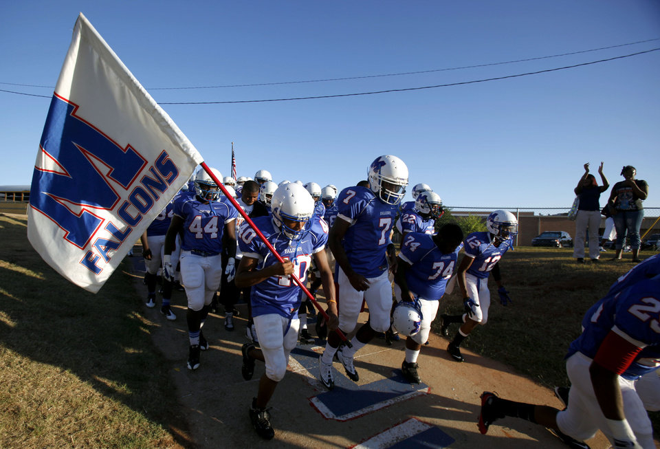 Photo - Millwood runs on to the field before the the high school football game between Millwood and Star Spencer, Friday, Sept. 3, 2010, at Millwood High School in Oklahoma City. Photo by Sarah Phipps, The Oklahoman