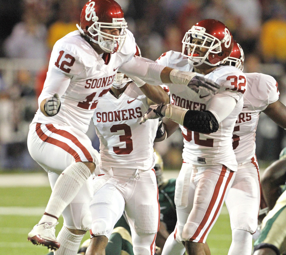 Austin Box (12) and Jamell Fleming (32) celebrate after Box stopped Baylor running back Jay Finley on a fourth and one to give the Sooners the ball inside Baylor teritory during the first half of the college football game between the University of Oklahoma Sooners (OU) and the Baylor Bears (BU) at Floyd Casey Stadium on Saturday, November 20, 2010, in Waco, Texas.   Photo by Steve Sisney, The Oklahoman