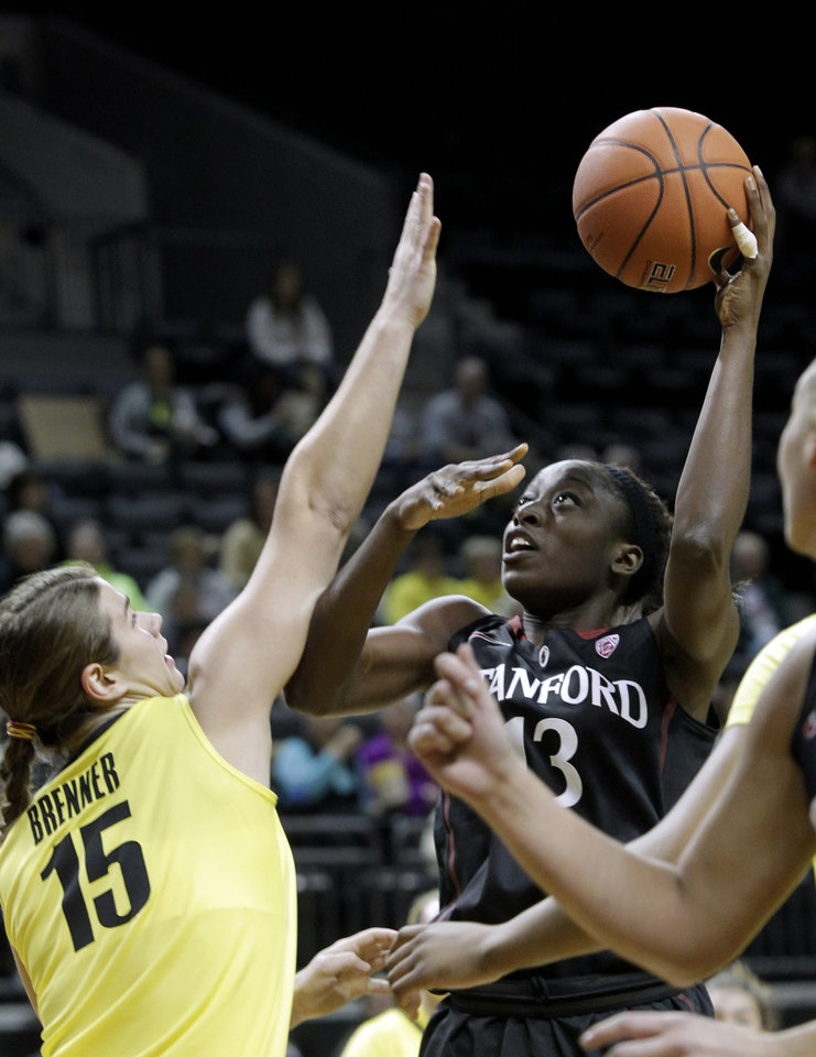 Photo - Stanford forward Chiney Ogwumike, right, shoots against Oregon forward Liz Brenner during the first half of an NCAA college basketball game in Eugene, Ore., Friday, Feb. 1, 2013. (AP Photo/Don Ryan)
