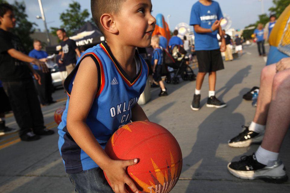 Photo - Elijah Garcia, 4, of Oklahoma City shoots baskets at Thunder Alley before Game 2 of the first round in the NBA playoffs between the Oklahoma City Thunder and the Dallas Mavericks at Chesapeake Energy Arena in Oklahoma City, Monday, April 30, 2012. Photo by Sarah Phipps, The Oklahoman