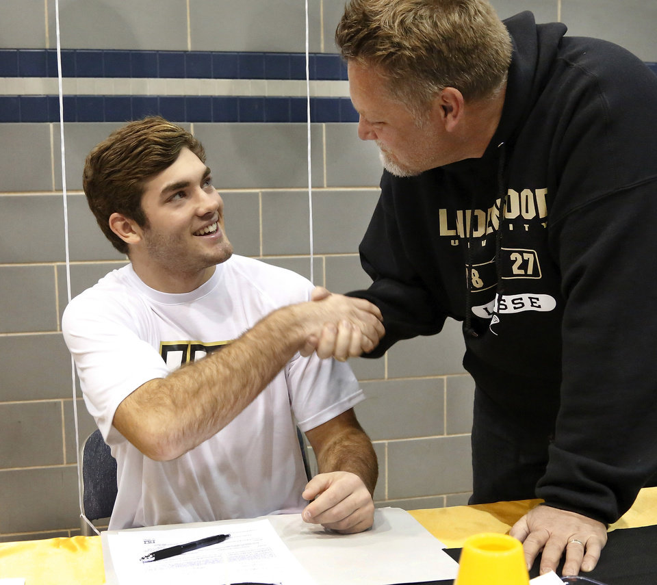 Jake Hobbs signed a letter of intent to play lacrosse at Lindenwood. Athletes from Edmond North High School signed national letters of intent with colleges and universities during a ceremony in the school's gymnasium Wednesday morning, Nov. 13, 2013. Various sports include golf, softball, wrestling,  lacrosse and others. Photo by Jim Beckel, The Oklahoman