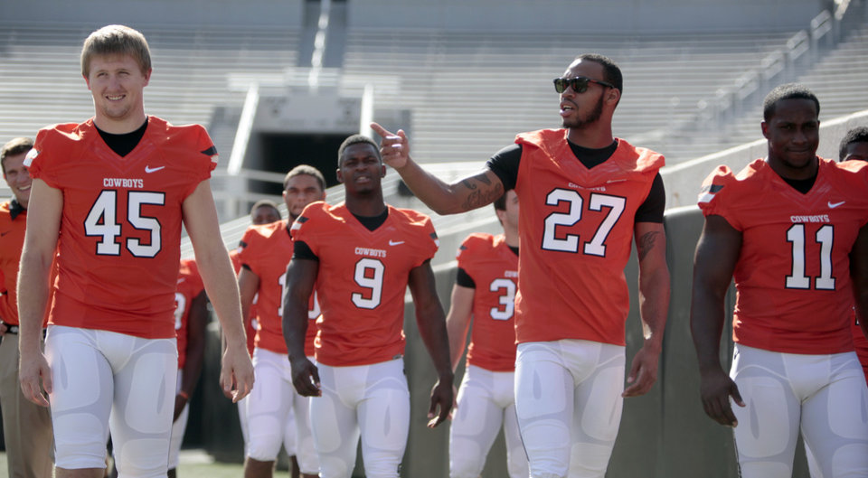 Photo - Lyndell Johnson walks onto the field during Oklahoma State's football media day in Stillwater, Okla., Saturday, Aug. 4, 2012. Photo by Sarah Phipps, The Oklahoman
