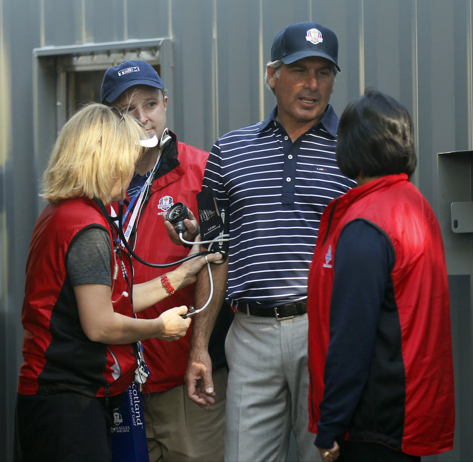 Photo -   Fred Couples has his blood pressure taken near the 12th hole during a four-ball match at the Ryder Cup PGA golf tournament Saturday, Sept. 29, 2012, at the Medinah Country Club in Medinah, Ill. (AP Photo/Charles Rex Arbogast)