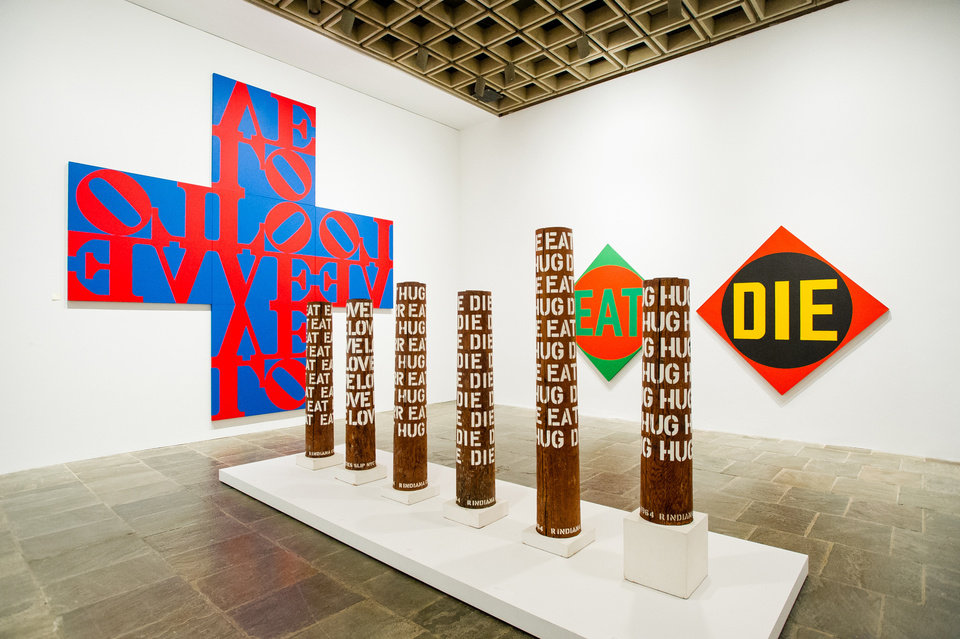 "In this Sept. 24, 2013 photo, the works of artist Robert Indiana, known world over for his LOVE image, are on display at New York's Whitney Museum of American Art. Indiana, who turned 85 this month, called the retrospective of 95 works he created over the past five decades, ""a dream come true, a little late."" (AP Photo/Lauren Casselberry)"