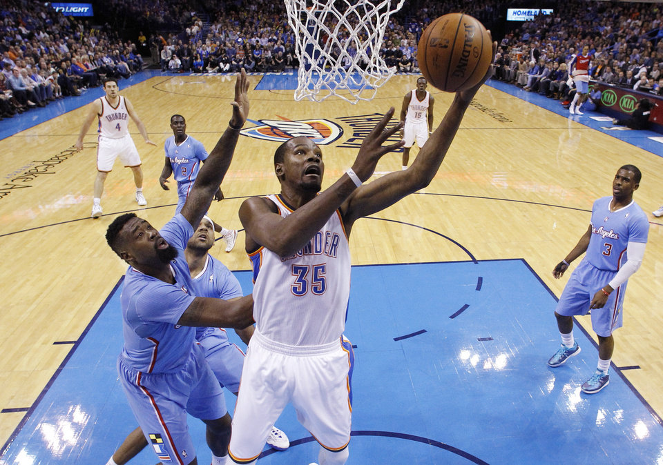 Oklahoma City Thunder forward Kevin Durant (35) shoots in front of Los Angeles Clippers center DeAndre Jordan (6) in the first quarter of an NBA basketball game in Oklahoma City, Sunday, Feb. 23, 2014. Los Angeles won 125-117. (AP Photo/Sue Ogrocki)