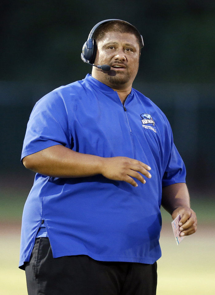 Photo - John Marshall coach Aso Pogi during a high school football game at Heritage Hall in Oklahoma City, Friday, Oct. 4, 2019. [Nate Billings/The Oklahoman]