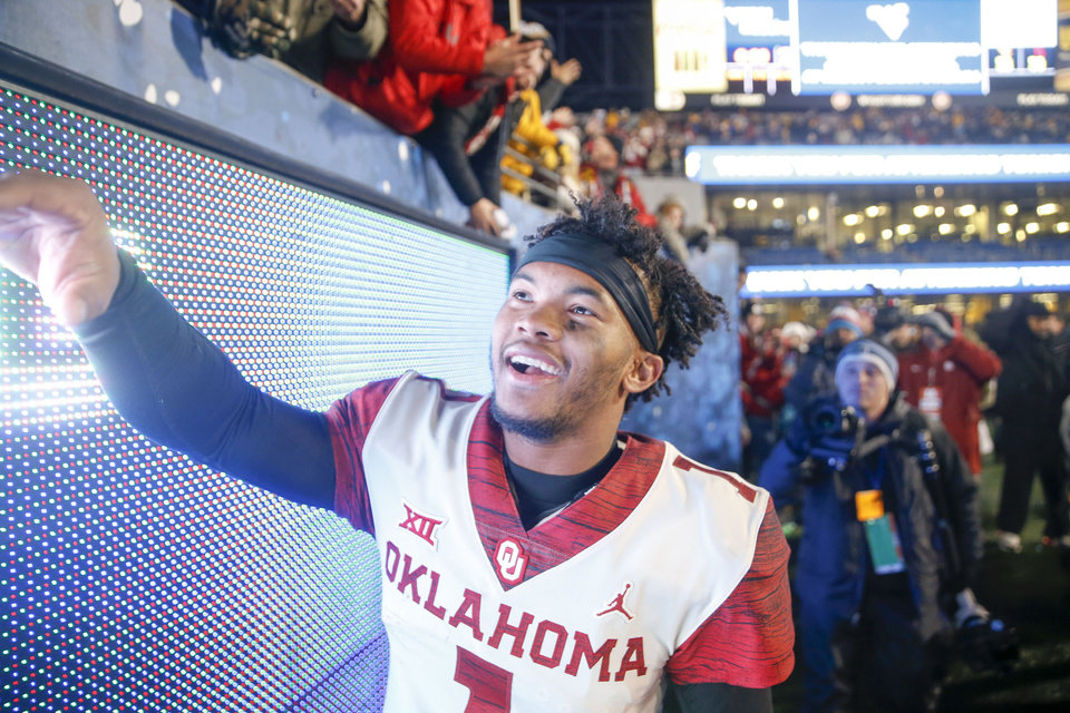 Photo - Oklahoma Sooners quarterback Kyler Murray (1) shakes hands with fans after his team's win over the West Virginia Mountaineers at Mountaineer Field at Milan Puskar Stadium in Morgantown, W.Va on Friday, November 23, 2018. The 59-56 win clinched Oklahoma a place in the Big 12 championship game against Texas. IAN MAULE/Tulsa World