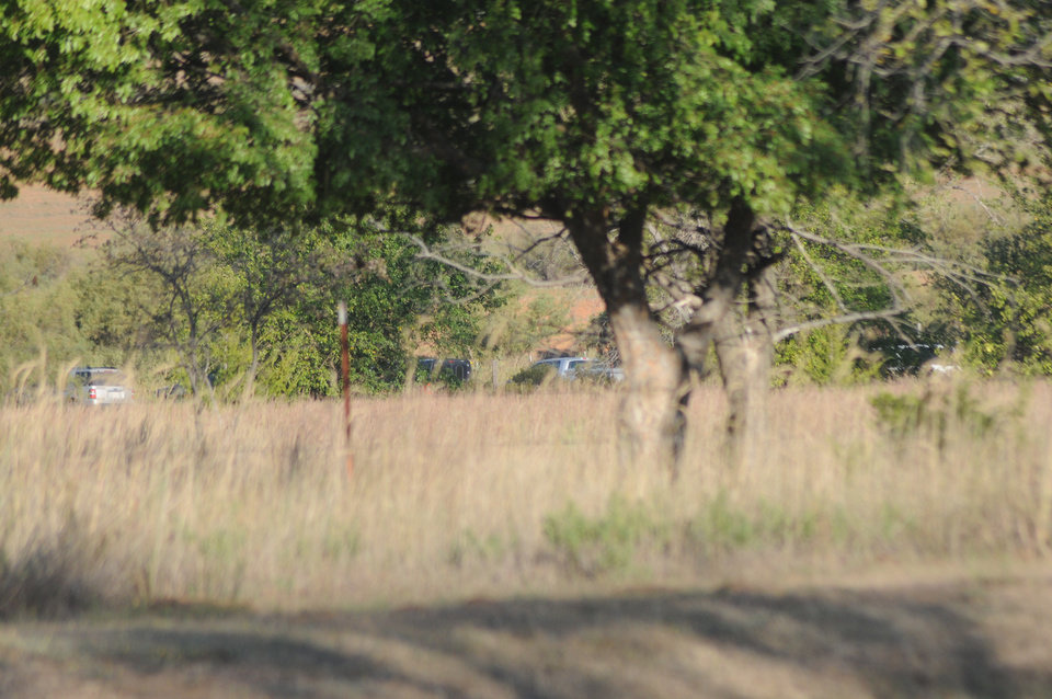 A line of vehicles can be seen parked near a field north of Fort Supply Lake where law enforcement officers are conducting an ongoing search for additional remains after some partial skeletal remains were discovered in the area Tuesday night.  (Photo by Rowynn Ricks, Woodward News)