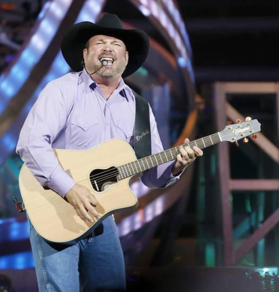 Photo - Garth Brooks performs during his 7 p.m. show at the Chesapeake Energy Arena in Oklahoma City, Friday, July 14, 2017. Photo by Nate Billings, The Oklahoman