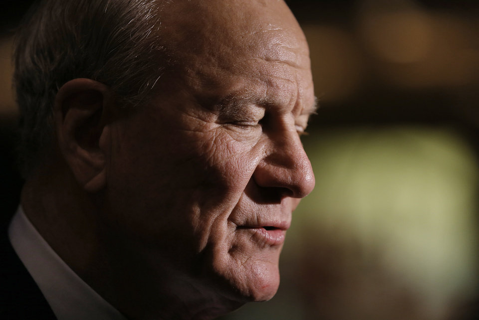Photo - Barry Switzer closes his eyes as he speaks about Steve Davis during the funeral services for former University of Oklahoma football player Steve Davis at the First Baptist Church on Monday, March 25, 2013, in Tulsa, Okla. Davis died in a plane crash last week in Indiana. Photo by Chris Landsberger, The Oklahoman