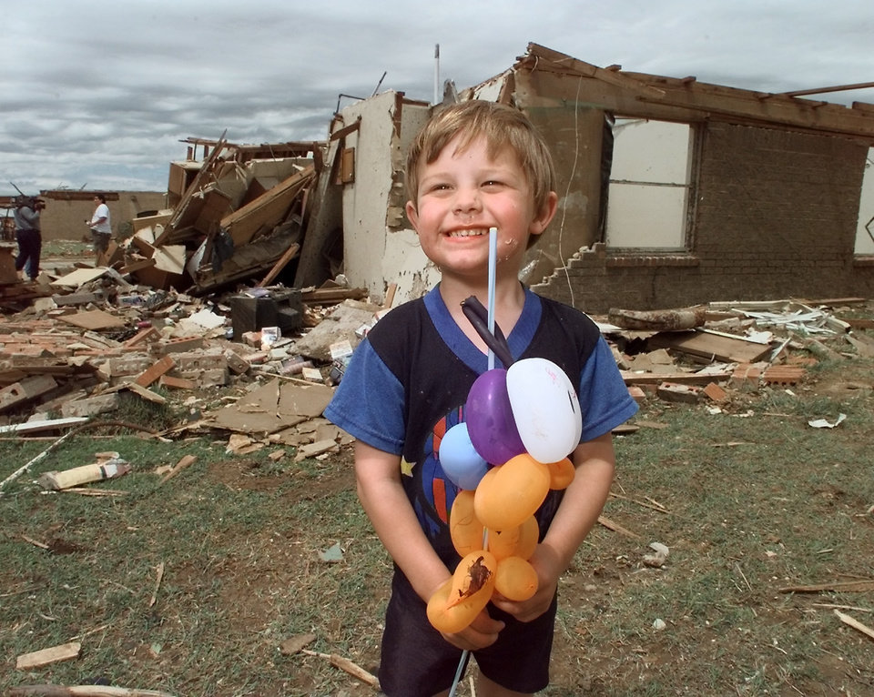 MAY 3, 1999 TORNADO: Tornado victims, damage: Matthew Chapman, today is his 4th birthday and the tornado took it away, in back is his house demolished   during Monday night's tornado in Moore. Goes with Baldwin/DeFrange story.