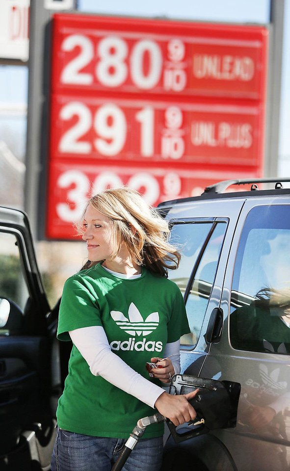 Suzanne Busby fills up her car's tank with gasoline Monday at 7-Eleven at NW 39 and Tulsa in Oklahoma City.  Photo By Steve Gooch, The Oklahoman
