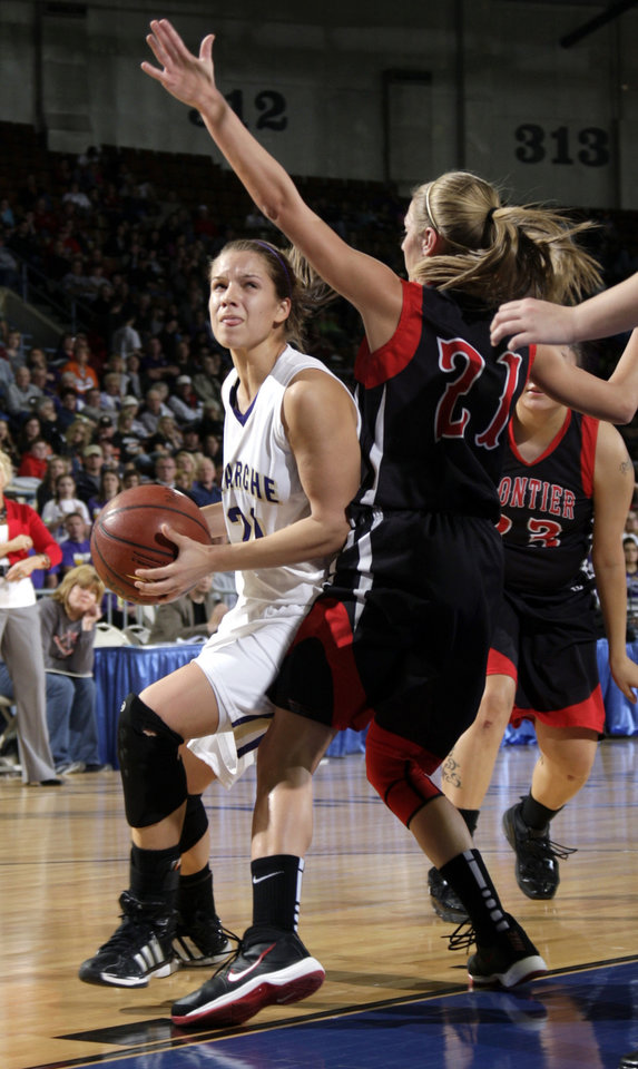Photo - Okarche's Randi Hufnagel shoots as Frontier's Jalissa Gum during the Class A girls state championship high school basketball game between Okarche and Frontier  at the State Fair Arena in Oklahoma City,  Saturday, March 3, 2012. Photo by Sarah Phipps, The Oklahoman