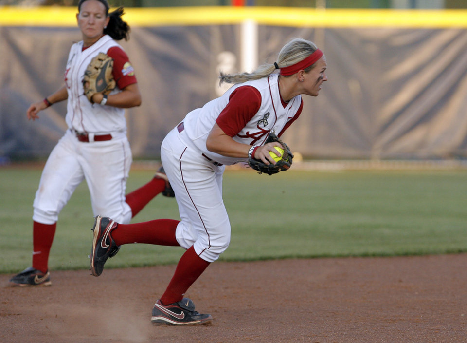 Photo - Alabama's Whitney Larsen (20) scrambles with a ball during the Women's College World Series game between Alabama and Florida at the ASA Hall of Fame Stadium in Oklahoma City, Sunday, June 5, 2011. Photo by Garett Fisbeck, The Oklahoman