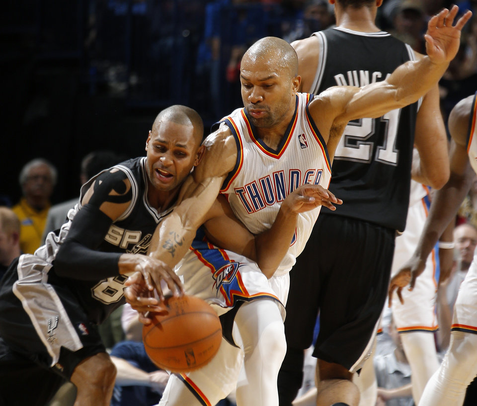 Photo - Oklahoma City's Derek Fisher (6) defends San Antonio's Patty Mills (8) during an NBA basketball game between the Oklahoma City Thunder and the San Antonio Spurs at Chesapeake Energy Arena in Oklahoma City, Thursday, April 3, 2014. Photo by Bryan Terry, The Oklahoman