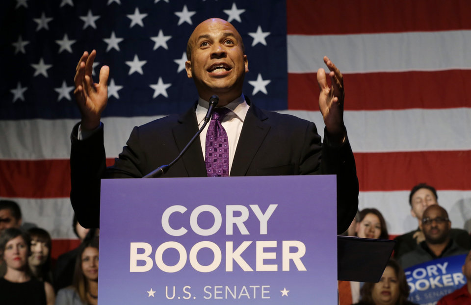 Photo - Newark Mayor Cory Booker talks to supporters during an election night victory party after winning a special election for the U.S. Senate, Wednesday, Oct. 16, 2013, in Newark, N.J. Booker and Republican Steve Lonegan faced off to fill the U.S. Senate seat left vacant by the death of Sen. Frank Lautenberg. (AP Photo/Julio Cortez)