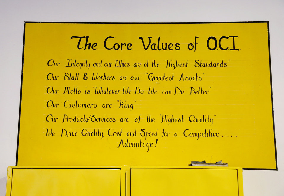 Photo - A large sign reminding inmates and educating visitors as to the core values of OCI hangs on the wall near the entrance of the building. Oklahoma Correctional Industries has prison inmates working in 10 locations throughout the state, manufacturing more than 7,000 products. They generate about $270,000 annually that is placed in the inmates' savings accounts. At Dick Conner Correctional Center in Hominy, the program now uses new laser equipment that can cut through several inches of steel. Photo taken Wednesday, Feb. 28, 2018. Photo by Jim Beckel, The Oklahoman