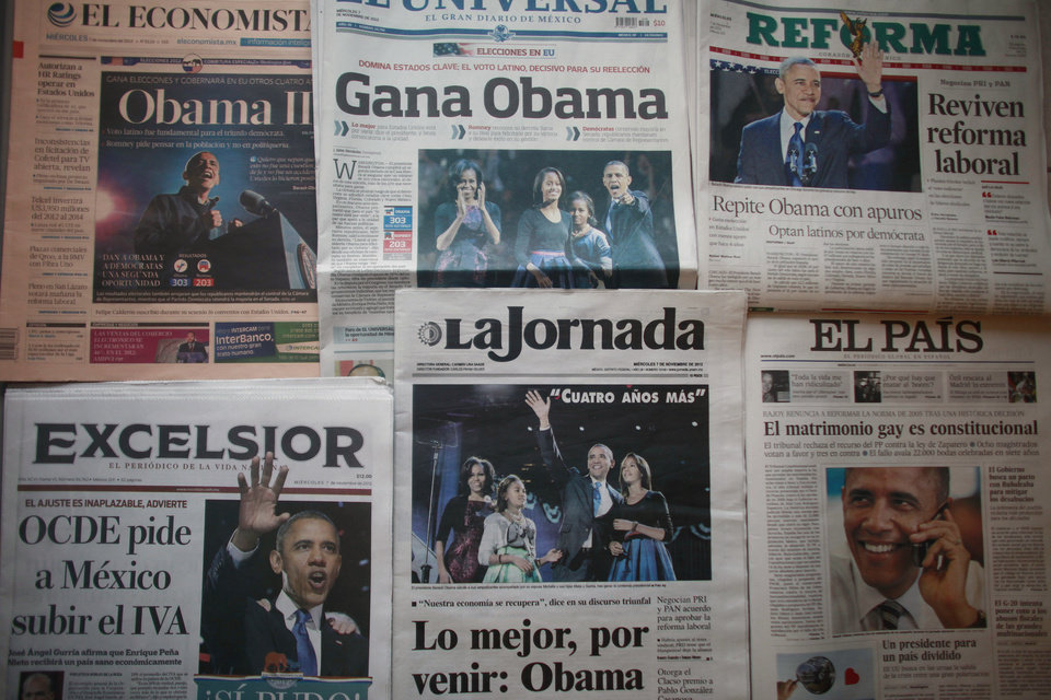Mexican newspapers carry front page photos and stories about the U.S. presidential election and President Barack Obama\'s re-election, the day after the U.S. presidential election in Mexico City, Wednesday, Nov. 7, 2012. (AP Photo)