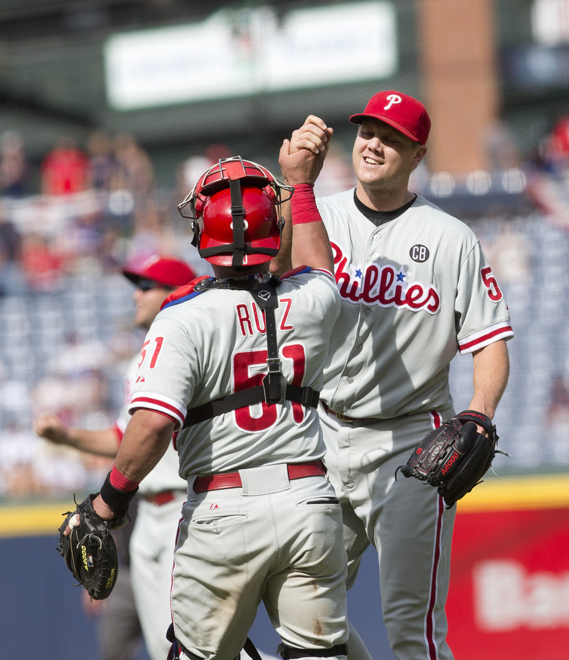 Photo - Philadelphia Phillies relief pitcher Jonathan Papelbon (58) celebrates with catcher Carlos Ruiz (51) after getting the final out in the ninth inning of a baseball game against the Atlanta Braves Monday, Sept. 1, 2014, in Atlanta. Papelbon combined with Cole Hamels, Ken Giles, and Jake Diekman for a no hitter. (AP Photo/John Bazemore)