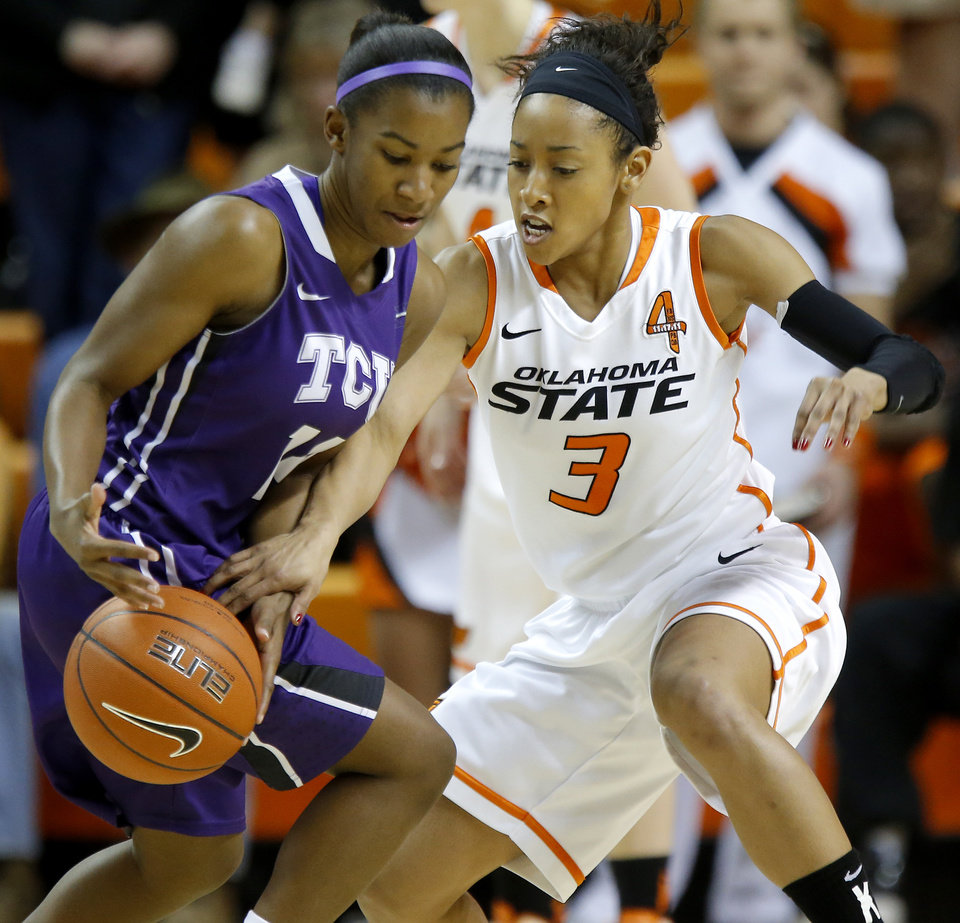 Photo - Oklahoma State's Tiffany Bias (3) tries to steal the ball from TCU's Zahna Medley (14) during a women's college basketball game between Oklahoma State University and TCU at Gallagher-Iba Arena in Stillwater, Okla., Tuesday, Feb. 5, 2013. Photo by Bryan Terry, The Oklahoman