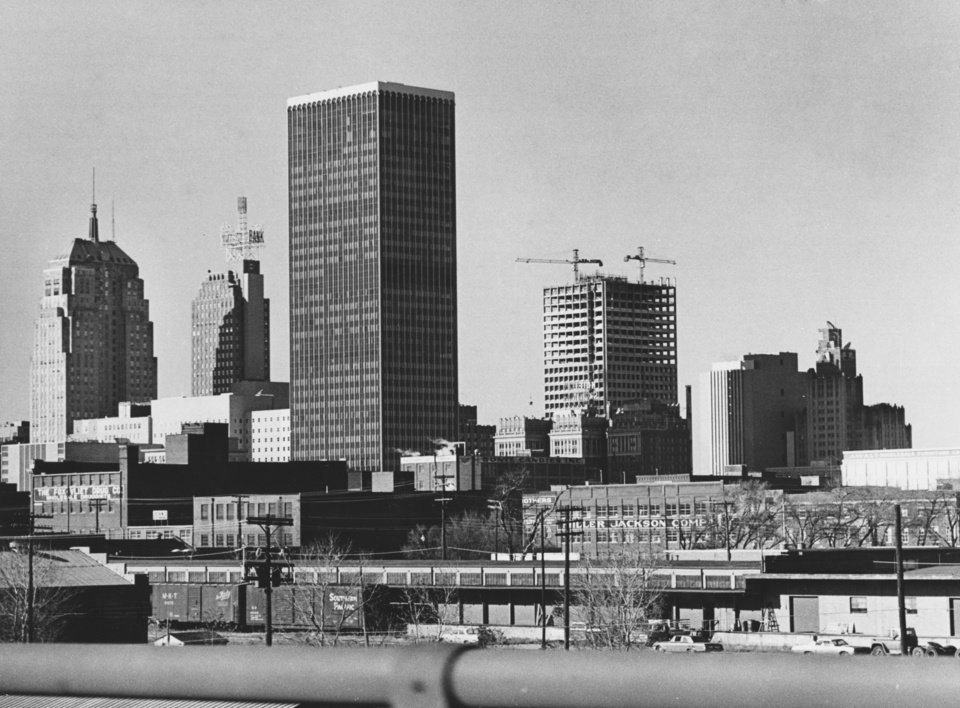 OKLAHOMA CITY / SKY LINE / OKLAHOMA:  CHANGING SKYLINE of downtown Oklahoma City changed some more during 1971.  Some landmarks including the historic Huckins Hotel, disappeared.  New buildings rose to blend with long-familiar structures in the new picture.  From left in this photo, taken from the Crosstown Expressway looking north, are the First National Bank Building, the City National Bank, the Liberty Tower, the Kerr-Mcgee Center and the telephone tower buildings.  The Fidelity Tower, which also climbed toward the sky this year, is not visible from this angle.  Staff photo by George Tapscott.  Photo undated and published on 01/01/1972 in The Daily Oklahoman.