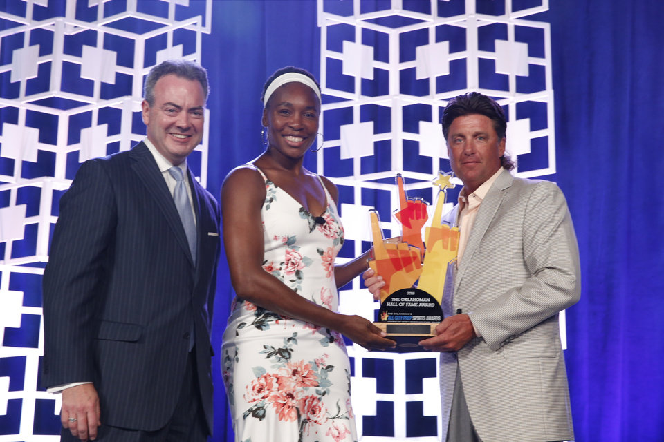 Photo - Oklahoman Publisher Chris Reen and Venus Williams present the Hall of Fame Award to Oklahoma State University head coach Mike Gundy at the Oklahoman's All-City Prep Sports Awards, celebrating top high school athletes, at the Cox Convention Center on Tuesday, June 26, 2018 in Oklahoma City, Okla.  Photo by Steve Sisney, The Oklahoman