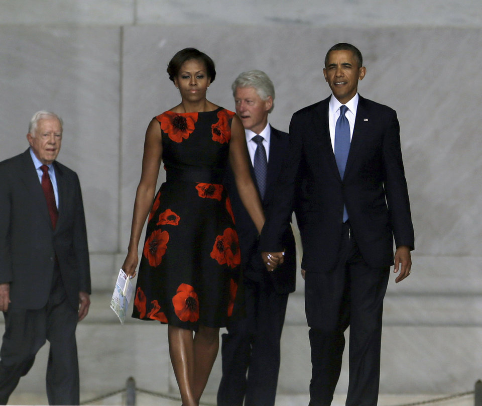 "President Barack Obama, first lady Michelle Obama, former President Bill Clinton and former President Jimmy Carter arrive at the Let Freedom Ring ceremony at the Lincoln Memorial in Washington, Wednesday, Aug. 28, 2013, to commemorate the 50th anniversary of the 1963 March on Washington for Jobs and Freedom. It was 50 years ago today when Martin Luther King Jr. delivered his ""I Have a Dream"" speech from the steps of the memorial. (AP Photo/Carolyn Kaster)"
