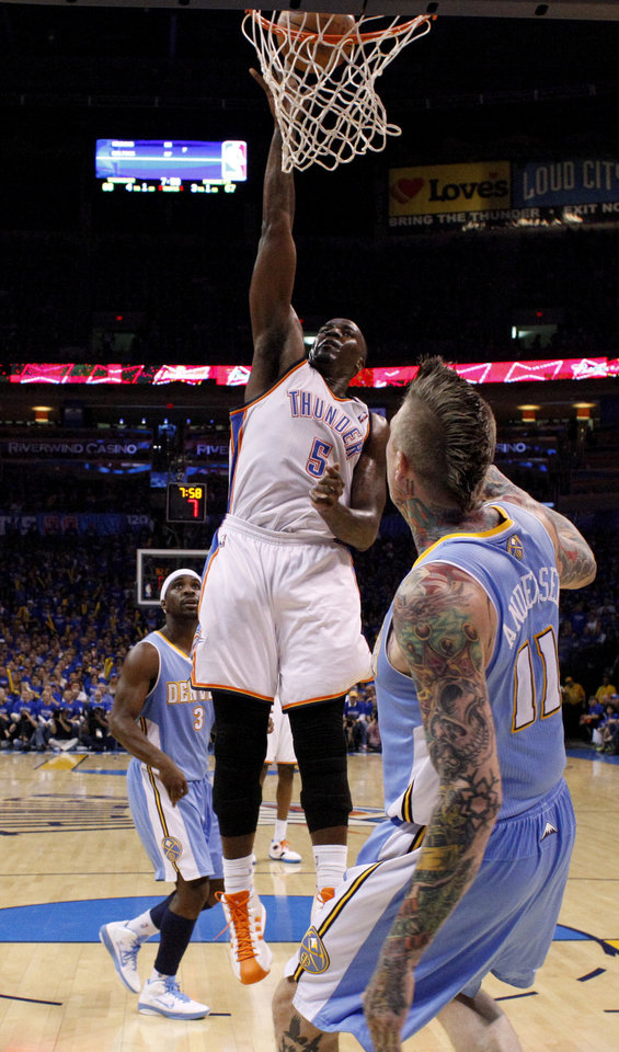 Oklahoma City\'s Kendrick Perkins (5) puts in a basket between Denver\'s Ty Lawson (3) and Chris Andersen (11) during the NBA basketball game between the Denver Nuggets and the Oklahoma City Thunder in the first round of the NBA playoffs at the Oklahoma City Arena, Sunday, April 17, 2011. Photo by Bryan Terry, The Oklahoman