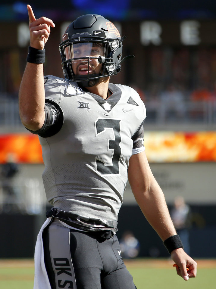 Photo - Oklahoma State's Spencer Sanders (3) reacts after a play in the first quarter during the college football game between the Oklahoma State University Cowboys and the Kansas Jayhawks at Boone Pickens Stadium in Stillwater, Okla., Saturday, Nov. 16, 2019. OSU won 31-13. [Sarah Phipps/The Oklahoman]