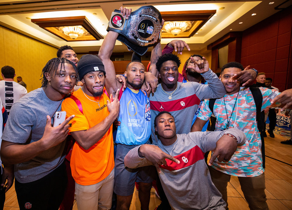 Photo - The Oklahoma Sooners celebrate their Battle for Bowl Week win earlier this week. [Jason Parkhurst via Abell Images for the Chick-fil-A Peach Bowl]