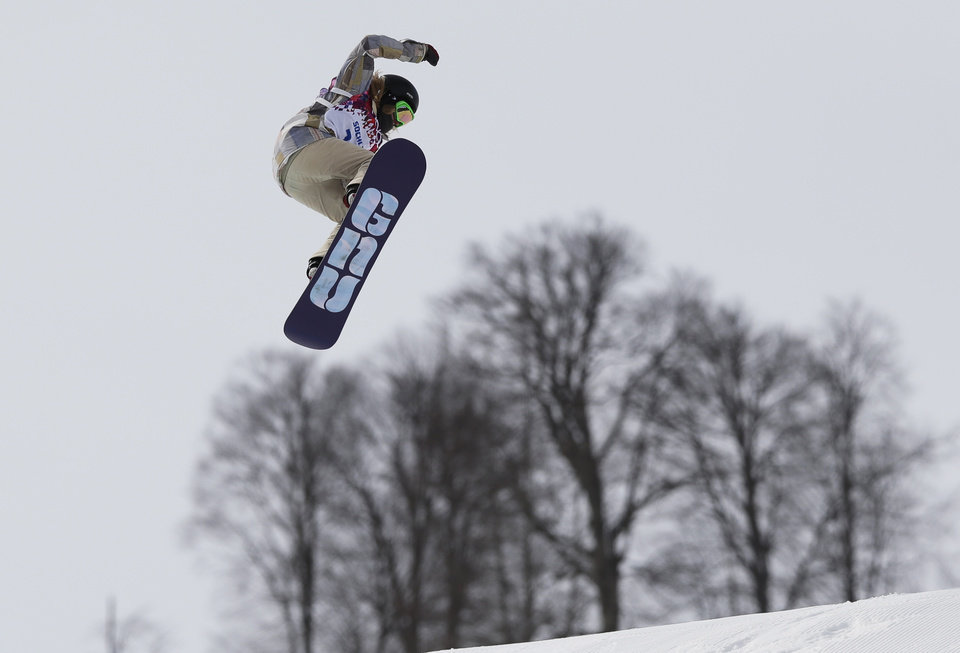 Photo - Jamie Anderson of the United States takes a jump on her final run in the women's snowboard slopestyle final at the 2014 Winter Olympics, Sunday, Feb. 9, 2014, in Krasnaya Polyana, Russia.  (AP Photo/Andy Wong)