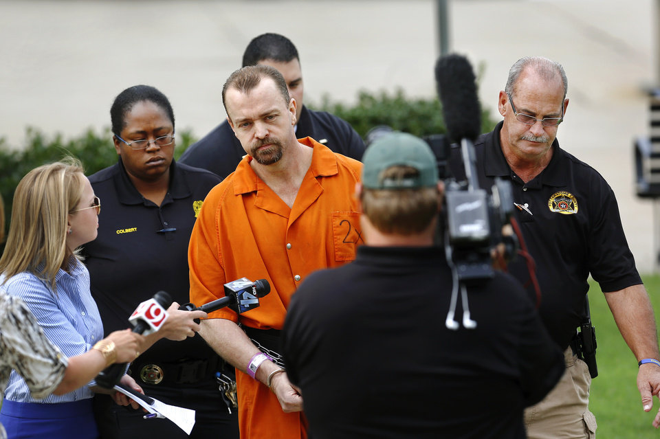 Photo - Glendon Carl Gouker  of Prague, charged in the 2010 killing a 19-year-old man and cramming the victim's body into an oil drum,  accepted a  deal offered by Pottawatomie County District Attorney Richard Smothermon and agreed to plead guilty to the murder of Ethan James Walton and to additional charges of rape, kidnapping, possession of a firearm during the commission of a felony and possession of a controlled drug with intent to distribute. Gouker admitted to killing Waltonwho was 19 at the time and sexually assaulting the victim's 20 year-old girlfriend.  He appeared in court in Shawnee on Thursday morning,  Aug. 15, 2013.    Photo  by Jim Beckel, The Oklahoman.