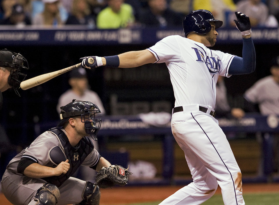 Photo - New York Yankees catcher Brian McCann, left, and Tampa Bay Rays' James Loney watch Loney's two-run double off New York pitcher Hiroki Kuroda during the fourth inning of a baseball game Friday, April 18, 2014, in St. Petersburg, Fla. (AP Photo/Steve Nesius)