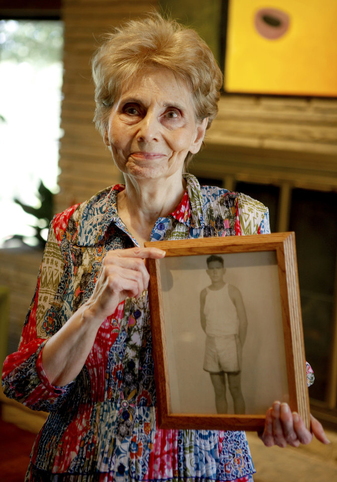 Photo - Norma Roupe holds a picture of her father, Andy Payne. Payne won the 1928 Trans-Continental Foot Race from Los Angeles to New York.  Photo by Bryan Terry, The Oklahoman
