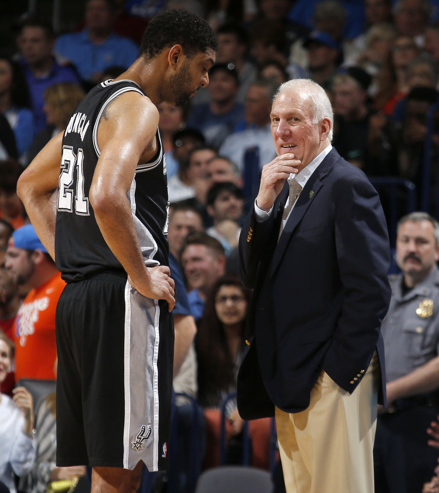 Photo - San Antonio coach Gregg Popovich talks with Tim Duncan during an NBA basketball game between the Oklahoma City Thunder and the San Antonio Spurs at Chesapeake Energy Arena in Oklahoma City, Thursday, April 3, 2014. Oklahoma City won 106-94. Photo by Bryan Terry, The Oklahoman