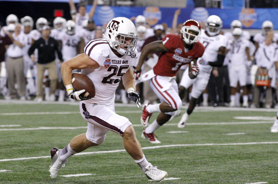 Photo - Texas A&M 's Ryan Swope (25) scores a touchdown during the Cotton Bowl college football game between the University of Oklahoma (OU)and Texas A&M University at Cowboys Stadium in Arlington, Texas, Friday, Jan. 4, 2013. Oklahoma lost 41-13. Photo by Bryan Terry, The Oklahoman