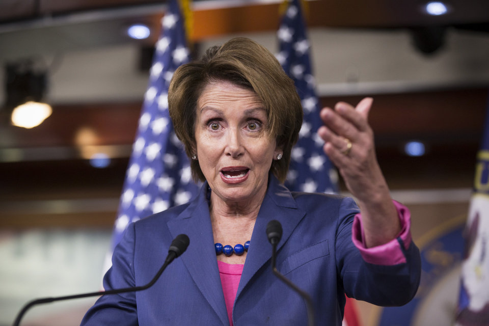 Photo - House Minority Leader Nancy Pelosi of Calif. gestures while speaking during a news conference on Capitol Hill in Washington, Friday, Sept. 27, 2013, as Congress continues to struggle over how to fund the government and prevent a possible shutdown. The top House Democrat announced that the Affordable Care Act, popularly known as