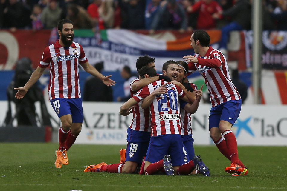 Photo - Atletico's Gabi, centre, facing camera, celebrates his goal during a Spanish La Liga soccer match between Atletico de Madrid and Real Madrid at the Vicente Calderon stadium in Madrid, Spain, Sunday, March 2, 2014. (AP Photo/Andres Kudacki)