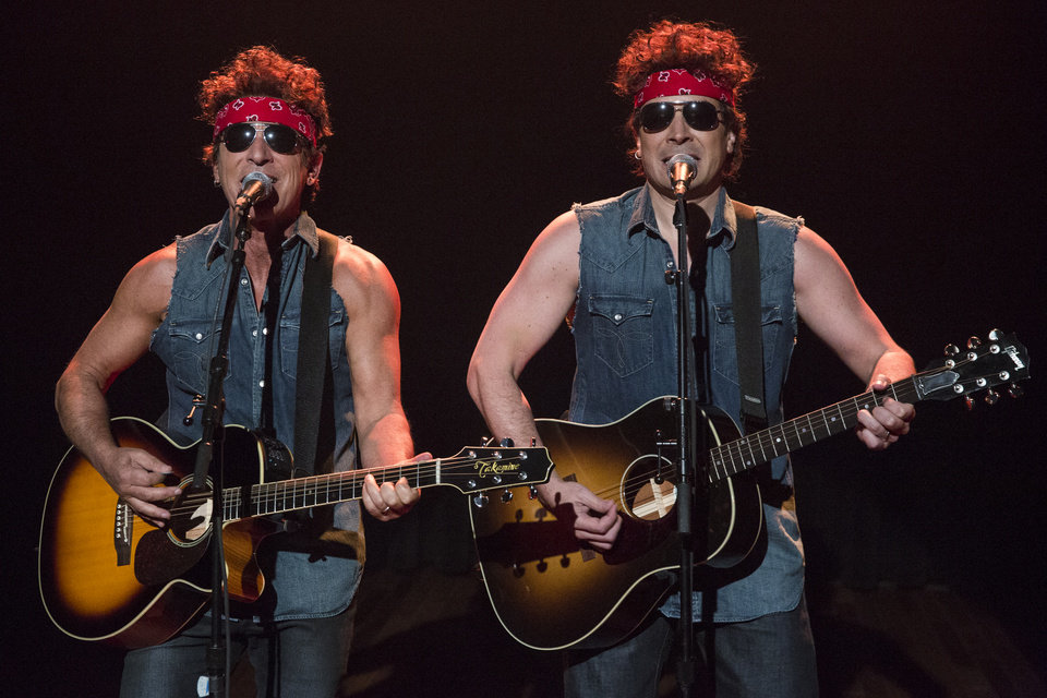 Photo - This image released by NBC shows Bruce Springsteen, left, and Jimmy Fallon performing during