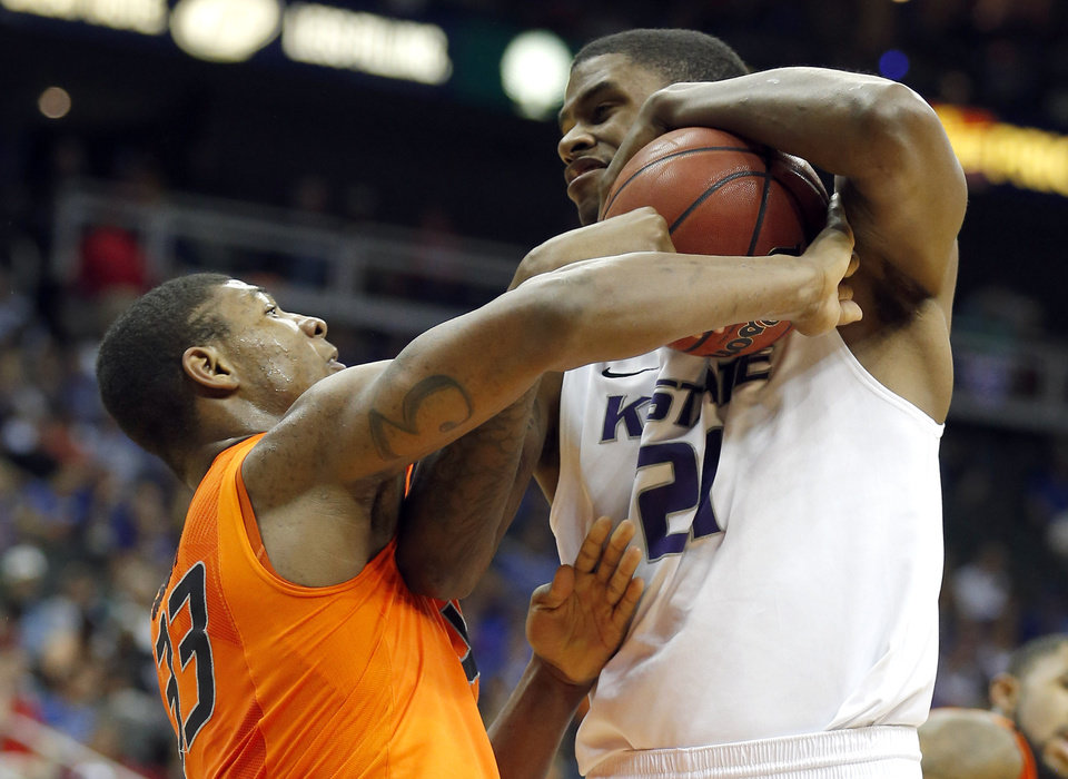 Kansas State's Jordan Henriquez (21) takes the ball away from Oklahoma State's Marcus Smart (33) during the Phillips 66 Big 12 Men's basketball championship tournament game between Oklahoma State University and Kansas State at the Sprint Center in Kansas City, Friday, March 15, 2013. Photo by Sarah Phipps, The Oklahoman